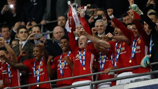 Despite not appearing on the field, Wayne Rooney lifted the Cup for United at the end of a pulsating final