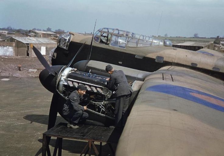 he Royal Air Force in Britain, June 1942 Mechanics work on the port engines of an Avro Lancaster, believed to be an aircraft of No 207 Squa...