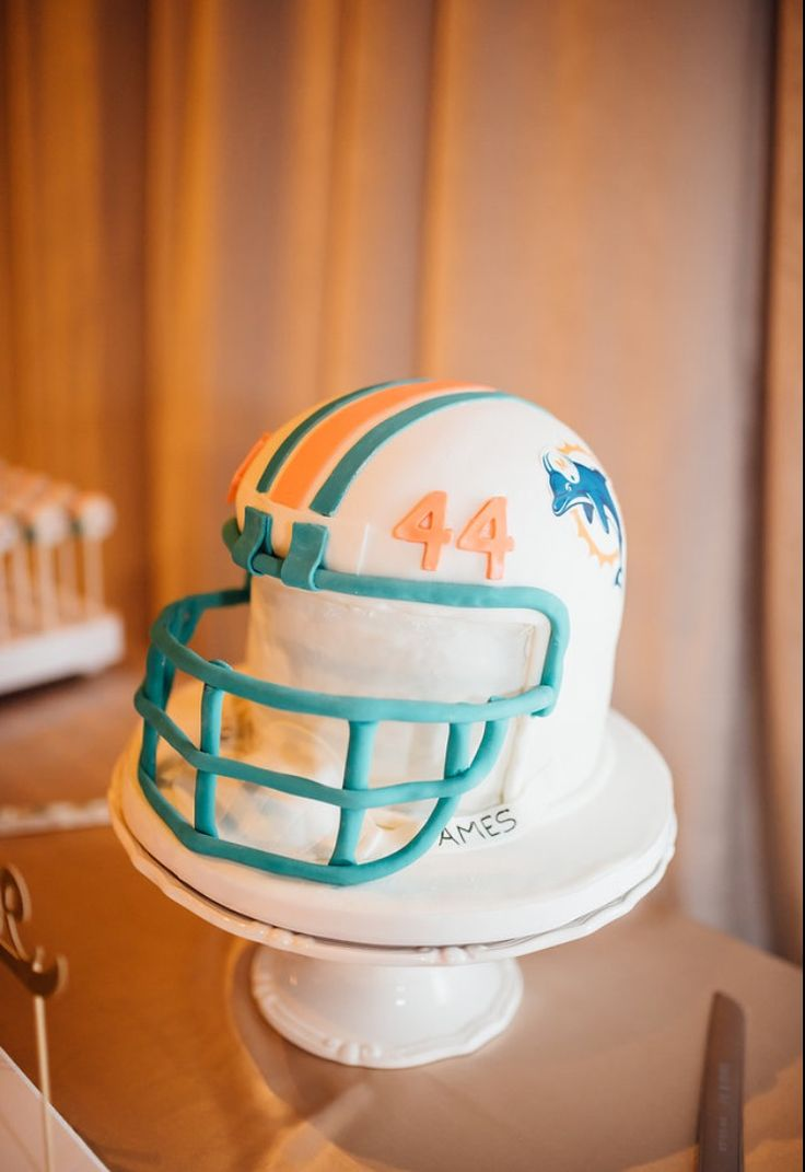 Miami Dolphins cake pops, grooms cake, Miami Dolphins wedding cake, football helmet cake, football fan, football Sunday, Wedding cake pops, unique wedding cake idea, wedding cake idea, party idea, gimme some sugar