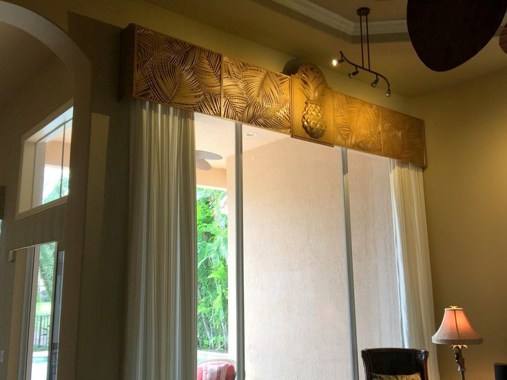Carved Palm Leaf panels combined with a Pineapple keystone for a great tropical valance - Carved wood