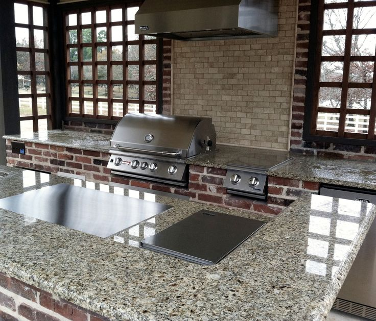 Ready for the weekend? We sure are! Looking forward to some time outdoors, and this lovely outdoor kitchen is definitely inspiring us to get grilling while we are at it.