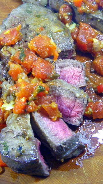 "Marinated Steak with Pizzaiola Sauce   (Bistecca marinata alla pizzaiola)    Beef, it's whats for dinner.  Start the marinade in the morning and this becomes a 30 minute meal.  The ""sauce"" is actually diced tomatoes simmered in their juices along with pizza seasonings until the juices have simmered out and the tomatoes are deeply seasoned.  Think a chunky BBQ sauce.  Plus simple (best way to cook a steak) instructions for cooking the steaks."