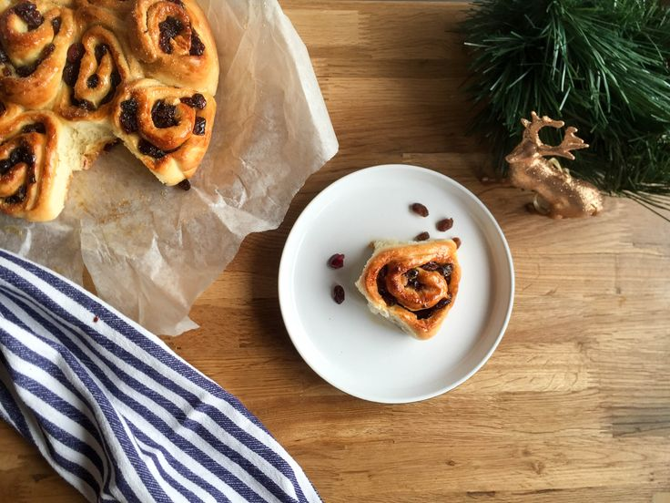 Christmas Chelsea Buns.  These chelsea buns are filled with cranberries and sultanas, then topped with a honey and orange glaze.