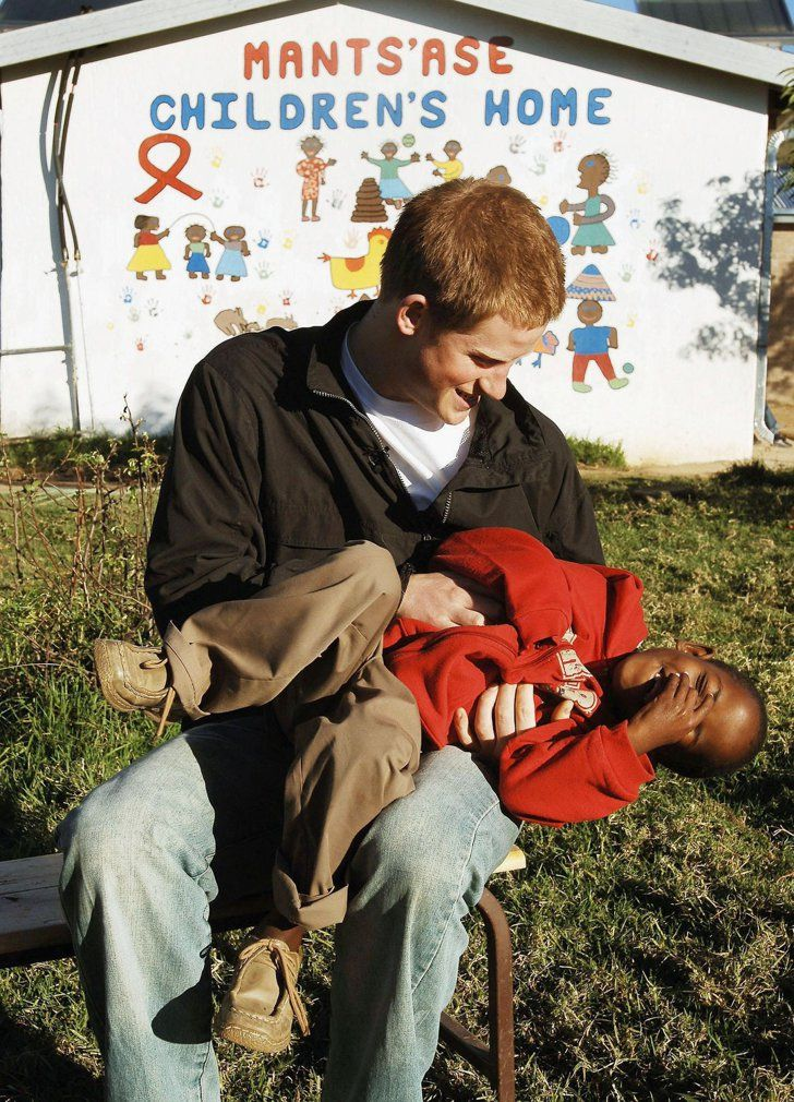 Pin for Later: 23 Times Prince Harry Was Out-of-Control Cute With Kids When He Tickled This Little Boy in Africa