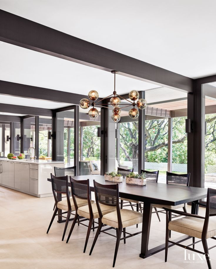 The Casual Yet Formal Dining Area Features A Maxalto Table Surrounded By Set Of Antique Paul McCobb Chairs Found At Roll Hill Modo Chandelier Was