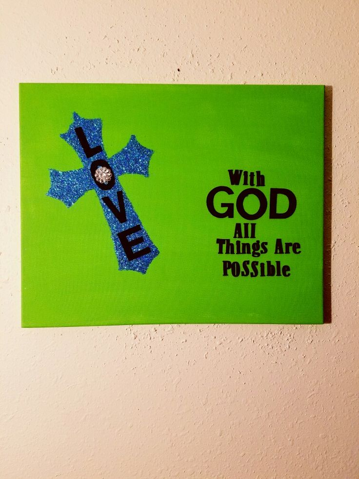 Blue and green love cross canvas art with glitter...