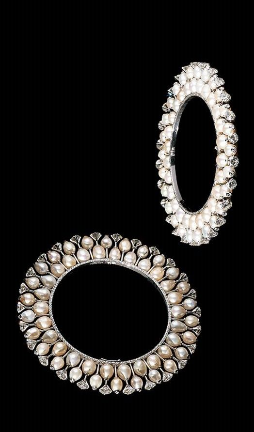 These bangles interpret the classic kada, a symbol of married status, with a slender finesse typical of Bhagat's work and reminiscent of belle-époque jewels. On the outside drop-shaped antique natural pearls, hand-selected by Bhagat, are set with a round diamond, while the inner rim is lined with fine micro-pavé-set diamonds.