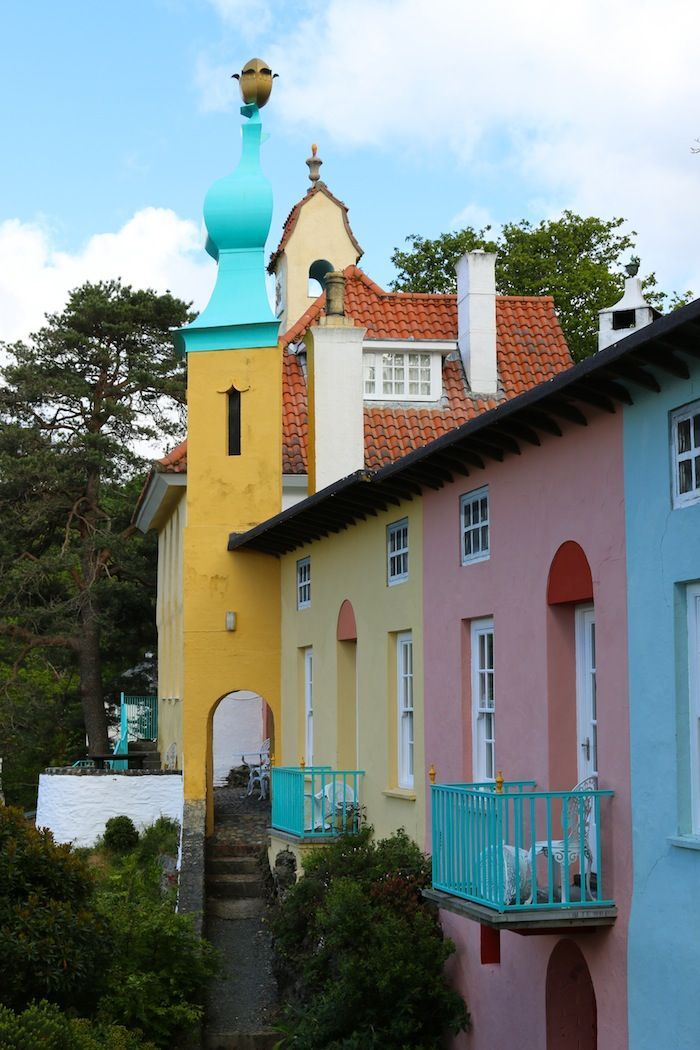 "Portmeirion Village in North Wales. Part of its charm is that this ""Italianate"" village designed by Sir Clough Williams Ellis looks fake, as if Toytown has been built on a very beautiful part of the Welsh coast."