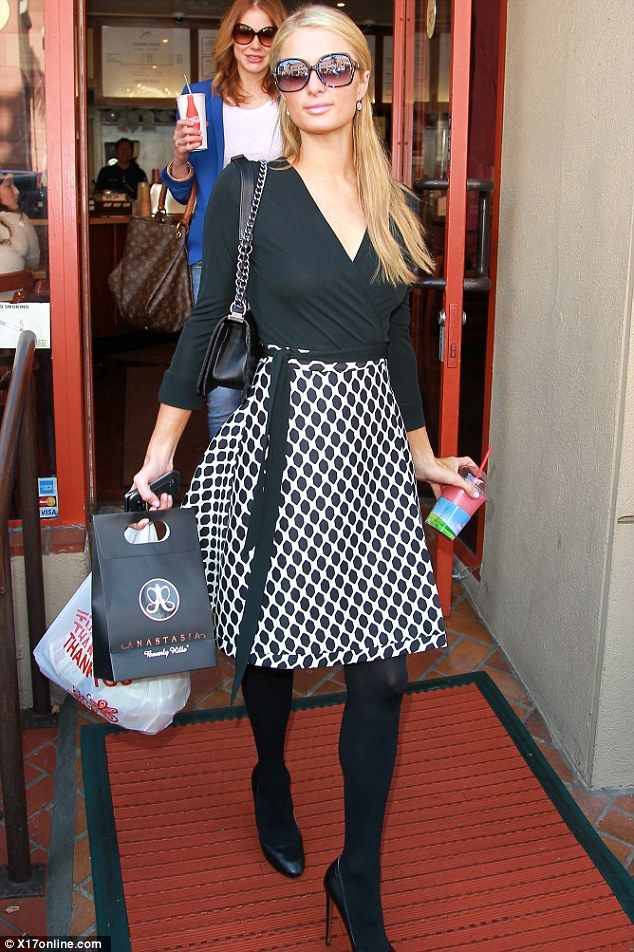 Out and about: Paris Hilton was seen further investing in her beauty routine as she left Anastasia Salon in Beverly Hills, with her bags of ...