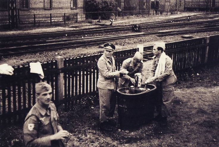 The officers of Fallschirmjäger-Brigade Ramcke wash their hands in a breaking point while on their way to Greece, at the summer of 1942, from left to right: unknown soldier, Major Friedrich August Freiherr von der Heydte, Oberleutnant Rolf Mager and Oberleutnant Horst Trebes. Pin by Paolo Marzioli