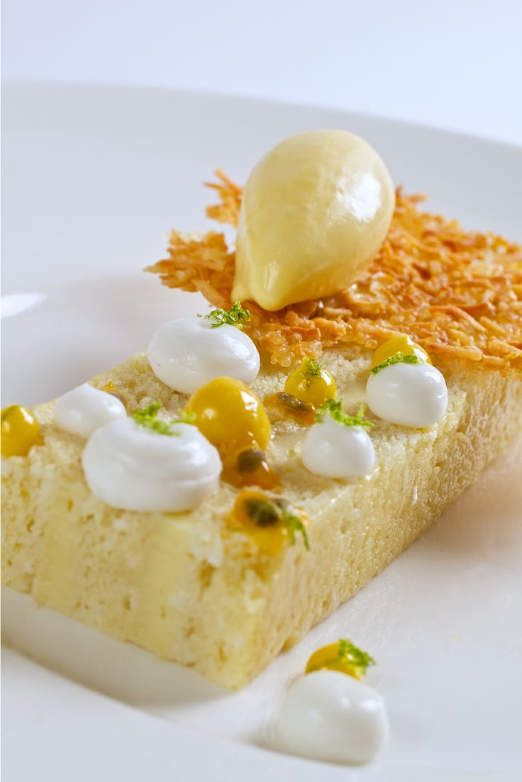 Coconut Cake with coconut lime purée, salted coconut crunch, & passion fruit ice cream.