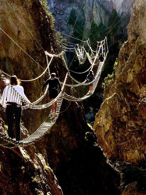 an adventurous path through the sky in Nepal..would you be brave enough to travel these bridges? #darleytravel