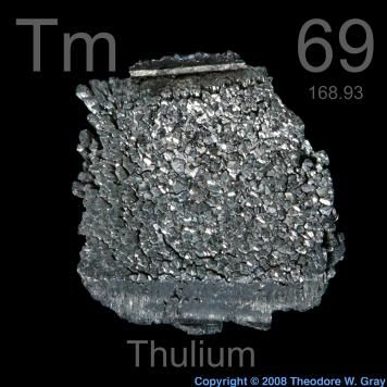 69 Thulium -Tm- A soft, silvery lanthanide metal that is fairly stable in dry air. It is the rarest 'rare earth' apart from Pm and has almost no applications.