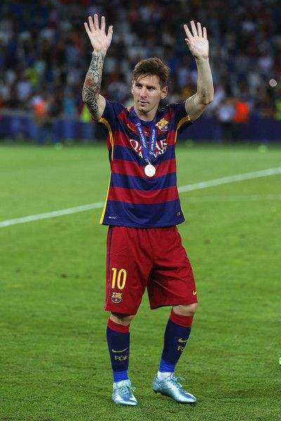 Lionel Messi of Barcelona celebrates with his winners medal after victory in the UEFA Super Cup between Barcelona and Sevilla FC at Dinamo Arena on August 11, 2015 in Tbilisi, Georgia.