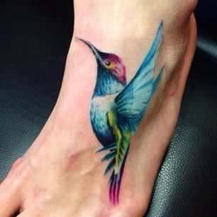 This colorful hummingbird. | 33 Amazing Tattoos For The Animal-Lover In You
