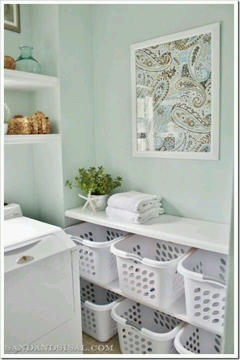 Built-in Laundry basket storage - bathroom makeover from @sandandsisal