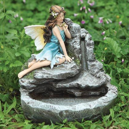 Samantha loves this Fairy Table Fountain  but not in proportion with the others :(  this fairy is larger- The GODDESS OF THE GARDEN??