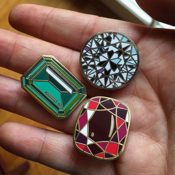 1 Ruby, 1 Diamond, and 1 Emerald 1 lapel pins  Ruby: 1 x 0.88 inch (2.6 x 2.1 cm)  Diamond: 1 x 1 inch (2.6 x 2.6 cm)  Emerald: 1 x 0.75 inch (2.6