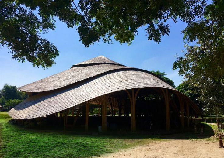 Local bamboo specialists Chiangmai Life Architects and Construction designed the Bamboo Sports Hall for the Panyaden International School in Chiang Mai, Thailand, which educates primary school-aged children using buddhist principles.