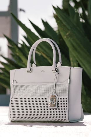 Geometric cutouts give this supple leather tote modern appeal. Wear it to punch up your look for brunch with friends or during your big presentation at the office.