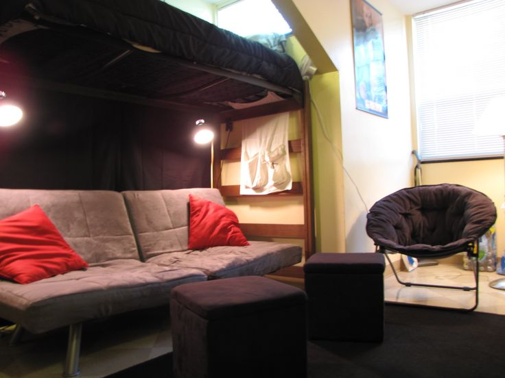 Guy dorm space...futon under loft.  Create a pop of color on the wall behind the futon...with a solid sheet hung from the bed. Use clip on lamps for additional lighting.