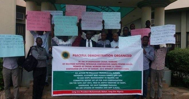 About 29 disengaged casual workers of the of the Nigerian National Petroleum Corporation (NNPC) on Thursday besieged the National Human Rights Commission (NHRC) Abuja office to protest the non-payment of their severance pay-off.  The aggrieved ex-workers said over N4 billion was owed them after working for 15 years at the corporation.  They arrived the NHRC bearing placards with inscriptions such as: We demand N4bn severance pay from NNPC after 15 years of slavery in NNPC Towers Abuja and…