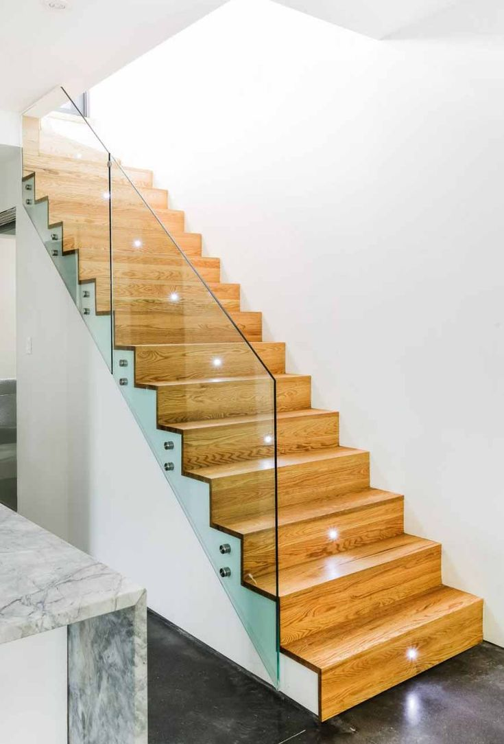 Foxy glass stair railings design feats wooden staircase - Glass and wood railing design ...