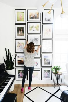 Large-scale gallery wall with family photos.