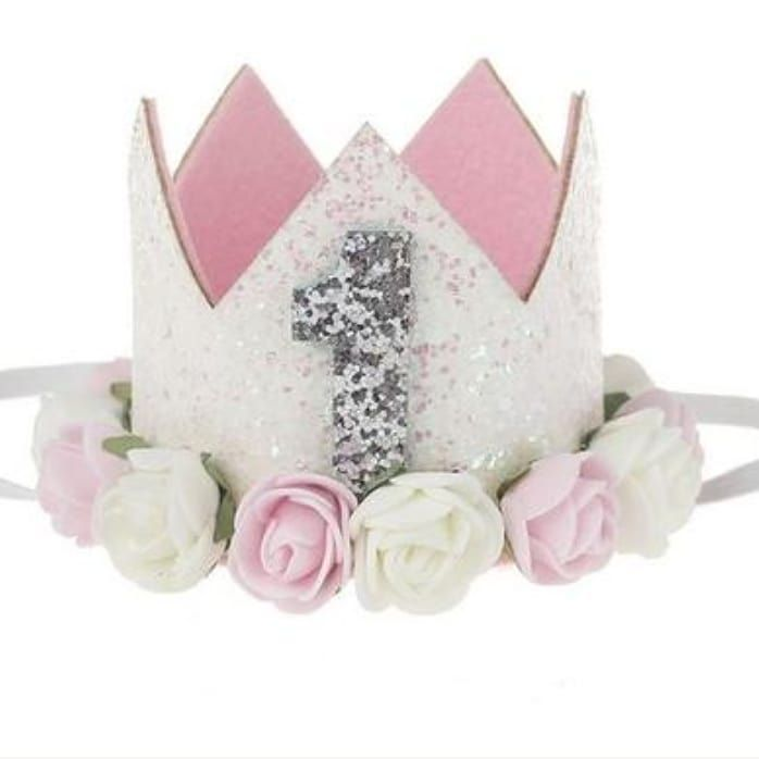 This dazzling crown was made for your birthday princess! Sparkling white glitter embellishes the crown, with dainty flowers surround the base of the crown! Add this crown to her outfit for your princess's birthday and add a little extra glam to her special day! @rufflesandbowtiebowtique #birthdaycrown #kidsbirthdaycrown #babysparklegrown #babyfirstbirthday