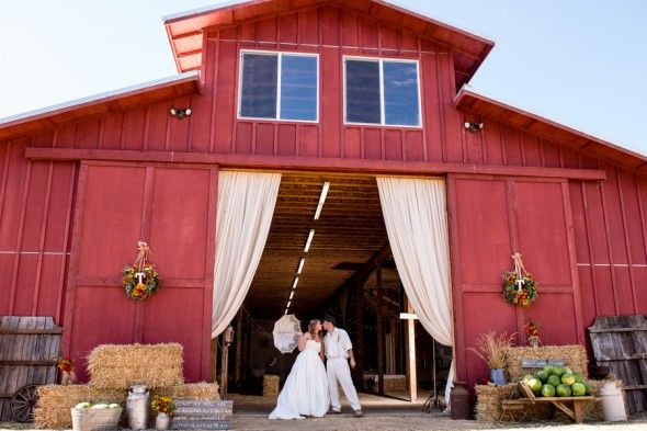 Upscale Barn Wedding  Published Fall of 2012  Barn. Wedding.  Weddings.  Country Weddings.  Red Barn.  Wedding Dress.  Hay bales.