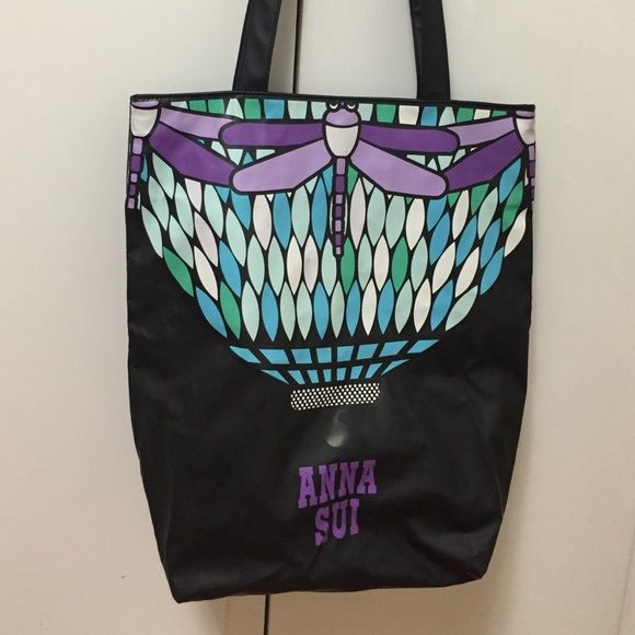 1 hr sale only till 2!!Anna Sui tote /- brand new. Brand new Anna Sui gorgeous print , nice & roomy , purple interior , zip inside w/ snap closure. Good for anything & everything including the beach , book bag , travel bag, carry on, etc- just a great all around tote - I have 2 identical so will sell 1 Anna Sui Bags Totes