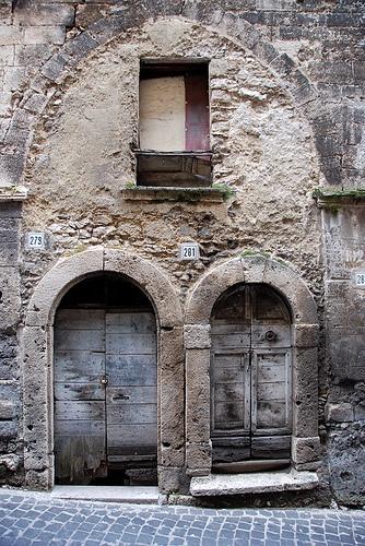 #279 & 281 in Ferentino, two ports in an arch, Frosinone, Lazio~