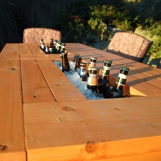 Step by step guide to make a patio table with built in beer / wine coolers. Choose when you want to use the coolers with lids to cover them. So cool.