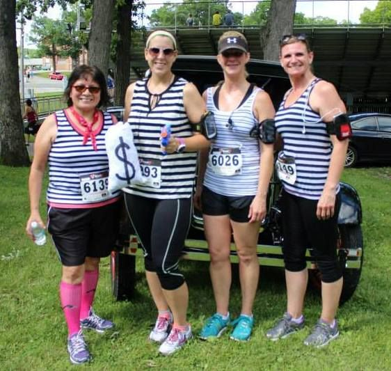 """Participants showing off their """"prison stripes"""" before the Public Enemy 5K Run & Walk at the Lake County Fairgrounds in Crown Point, IN."""