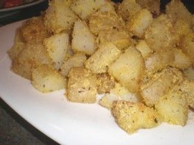 Crispy Polenta Potatoes.    Potatoes tossed in a herby potenta mixture and then baked.  For the full recipe see: http://www.cheap-and-easy-recipes.com/individual-recipes/polenta-potatoes.php