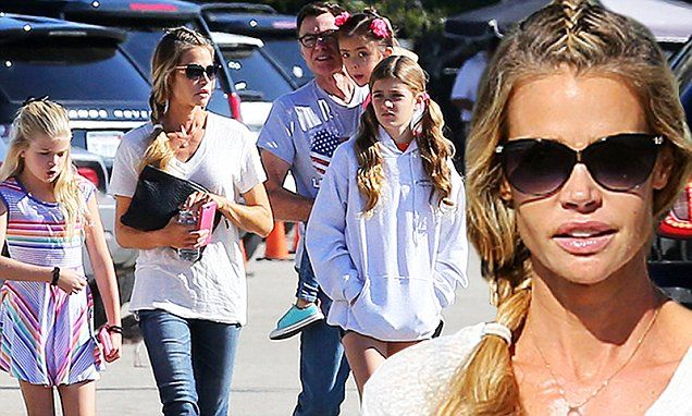 Denise Richards takes dad Irv and her three daughters out for a stroll