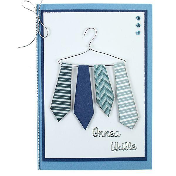 Pehmeästä alumiinilangasta väännettyyn hengariin on kiinnitetty kuviopapereista leikattuja kravatteja.