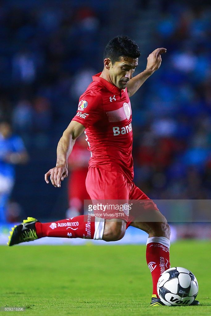 Antonio Naelson of Toluca drives the ball during the 10th round match between Cruz Azul and Toluca as part of the Torneo Apertura 2016 Liga MX at Azul Stadium on September 20, 2016 in Mexico City, Mexico.
