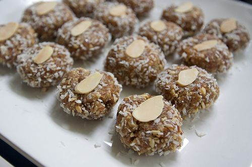 Coconut Date Rolls 1 lb. pitted dates 1 cup slivered almonds, roasted 1 cup unsweetened dried coconut flakes (reserve some for rolling) Blend the dates, almonds & coconut in a food processor until a paste is formed. Roll heaping tablespoonfuls of the paste in the dried coconut and form into 1-2 inch balls. Top with …