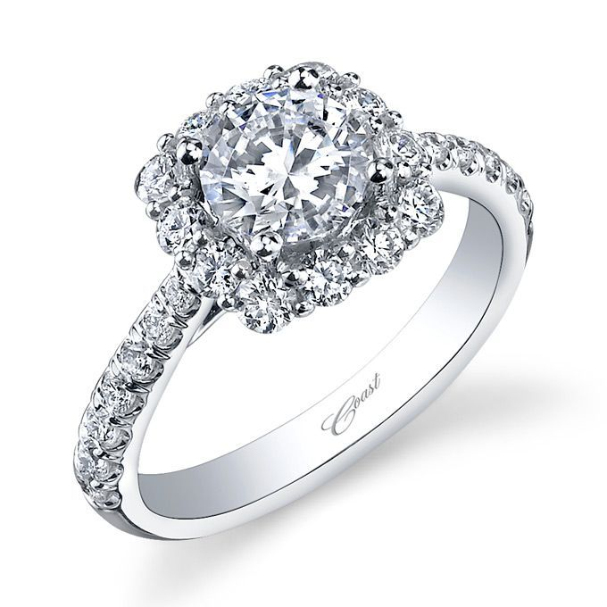 A generous cushion-shaped halo of round diamonds makes this engagement ring a sparkling symbol of true love. Diamonds cascade down the shoulders of the shank, adding to the impact of this radiant ring. Total diamond weight .78 carats, created for a 1 carat center stone. From the Charisma Collection. Available in 14K or 18K white, yellow, or rose gold, and platinum. LC5257