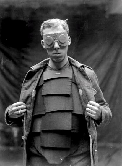 British body armour, 1917. The first official attempts at commissioning body armor were made in 1915 by the British Army Design Committee, in particular a 'Bomber's Shield' for the use of bomber pilots who were notoriously under-protected in the air from stray bullets and shrapnel.