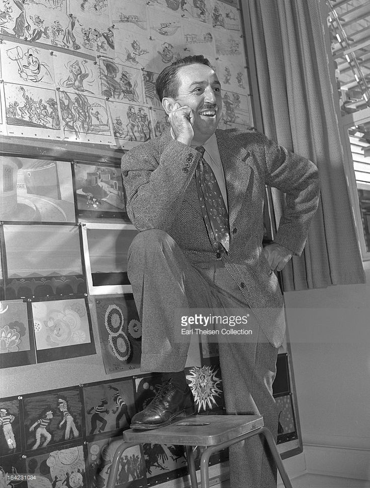Walt Disney poses for a portrait next to a Donald Duck storyboard circa 1945 in Los Angeles, California.