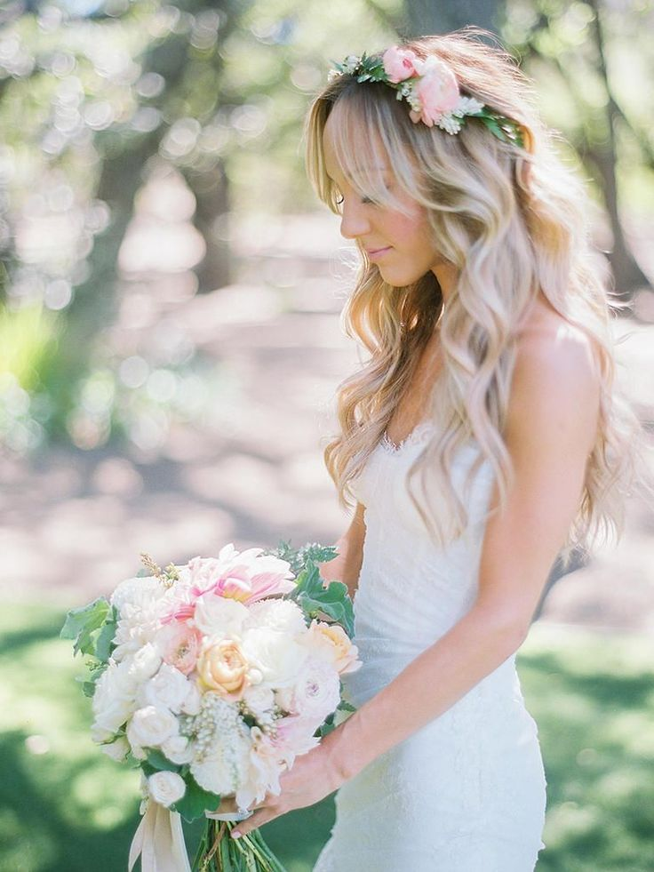 Channel your inner flower-child with a loose curls wedding hairstyle paired with pink ranunculus and white japonica pieris.