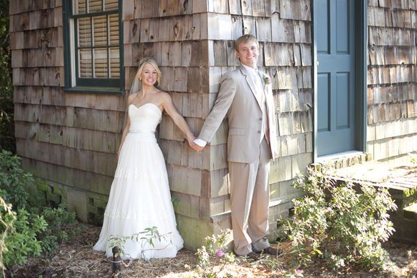 The couple wanted to get a picture before the wedding without seeing each other so, the groom was blindfolded and lead to the corner of the house, where the bride was waiting.. So cute!