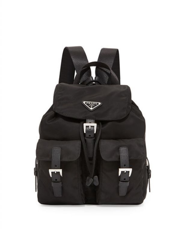 Prada Vela Two pocket backpack  #112143- Prada nylon backpack. Web top handle and adjustable shoulder straps Front flap pockets with saffiano leather buckles. Buckled flap top with logo plate. Drawstring cinches top. Made in Italy