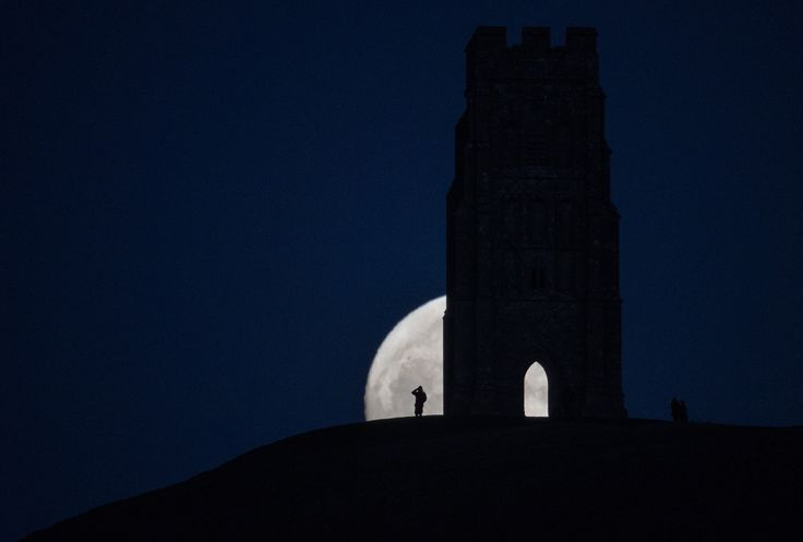 GLASTONBURY, ENGLAND - JANUARY 11:  A so-called wolf moon rises over Glastonbury Tor on January 11, 2017 in Somerset, England. In some parts of the world, the January full moon is nicknamed the wolf moon, which dates back to the days when native American tribes gave names to each month's full moon to help keep track of the seasons. The full moon was visible ahead of a forecast for wind and snow hitting parts of the UK tomorrow. .  (Photo by Matt Cardy/Getty Images) via @AOL_Lifestyle Read…