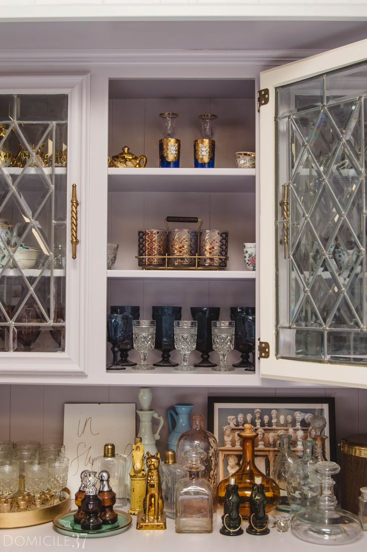 Simple bar cabinet styling, Styling collected decor, styling decanter, styling glassware, curating bar cart, purple cabinets, Bar cabinet built-ins, glassware storage, vintage eclectic style