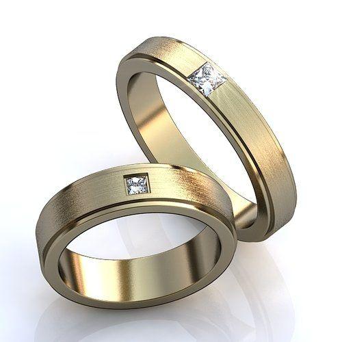 Обручальные кольца с одним бриллиантом