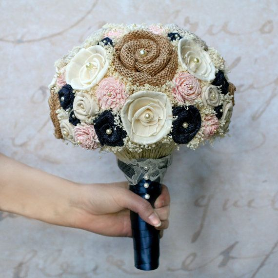 This soft pink and navy blue bouquet has so many pretty swoonworthy details. With custom dyed pale pink sola wood flowers, mixed ivory sola wood