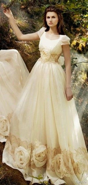 """Don't normally like """"modest"""" wedding gowns, but something about this one is so rustic/indie/floaty that I kind of like it."""